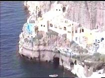 caves below hamlet under the cliffs- Santorini